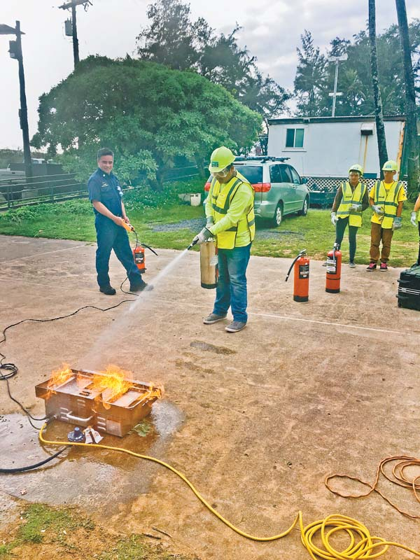 Baldwin High School freshman Desmond Kekani, 15, trains with a fire extinguisher at the Paia Youth & Cultural Center with help from the Maui County Fire Prevention Bureau. Photo courtesy of Loren Lapow
