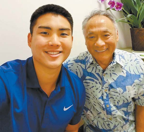 Justin Yanagida poses with Wayne Wong, director of the Maui Small Business Development Center. Yanagida has released a book on health and fitness.