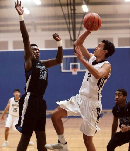 Kamehameha Schools Maui's Kahai Bustillos goes up for a shot against Kapolei's Zoar Nedd in the first quarter of the Warriors' 49-34 loss to the Hurricanes in a Snapple Boys Basketball Division I Championship first-round game Monday. The Maui News / CHRIS SUGIDONO photos