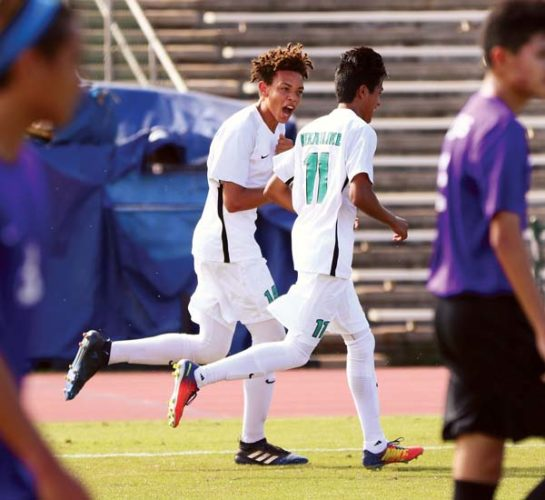 Zakariya Woolley (left) of King Kekaulike High School celebrates with Jerycho Medeiros after scoring his second goal in the first half of Na Alii's 2-1 victory over Pearl City in a first-round match of The Queen's Medical Center Boys Soccer Division I State Championship on Monday at War Memorial Stadium. The Maui News / CHRIS SUGIDONO photos