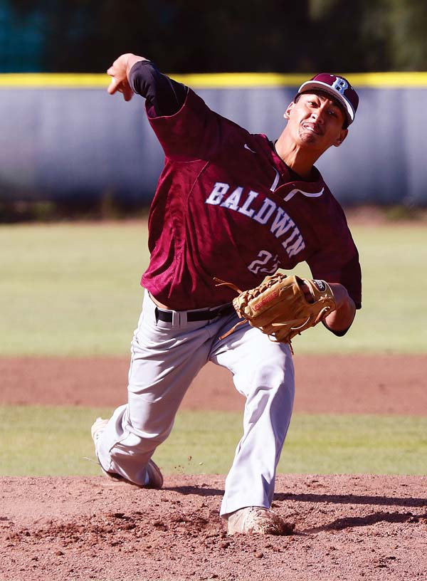 Anthony Hoopii-Tuionetoa of Baldwin High School pitches during the Bears' 4-4 tie with Maryknoll in the Maui High School Invitational last week at Maehara Stadium. The Maui News / CHRIS SUGIDONO photo