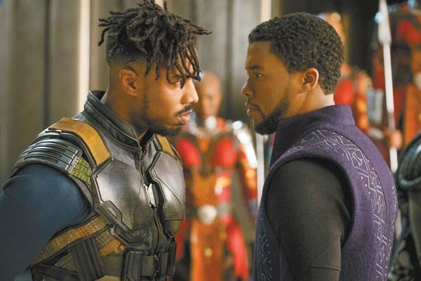 "Michael B. Jordan (left) and Chadwick Boseman star in Marvel Studios' ""Black Panther."" Marvel Studios-Disney via AP"