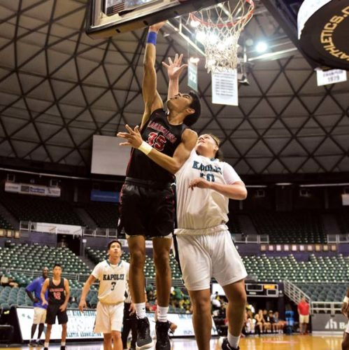 Lahainaluna High School's Aukai Kama shoots a layup against Kapolei's Julius Buelow during the Lunas' 57-55 victory over the Hurricanes on Friday. -- GLEN PASCUAL photo