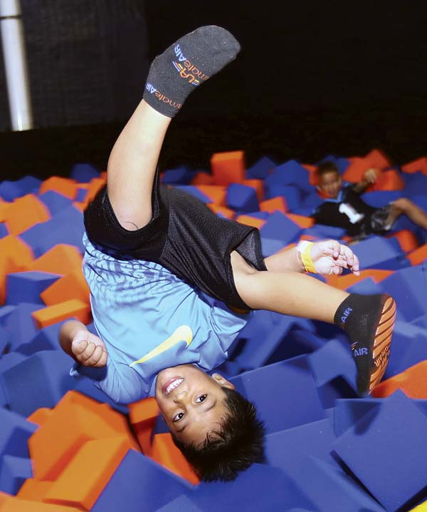CJ Kaanana, 5, of Kahului flips into a foam pit Friday afternoon at the Ultimate Air Trampoline Park in the Maui Lani Village Center. -- The Maui News / CHRIS SUGIDONO photo