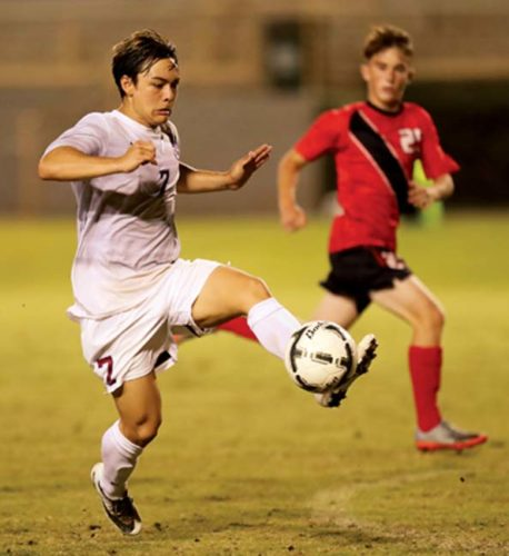Angelo Deloso-Flocco of Baldwin High School controls the ball during the Division I championship game of The Queen's Medical Center Boys Soccer State Championships on Saturday night at the Waipio Peninsula Soccer Stadium. -- ANDREW LEE photo