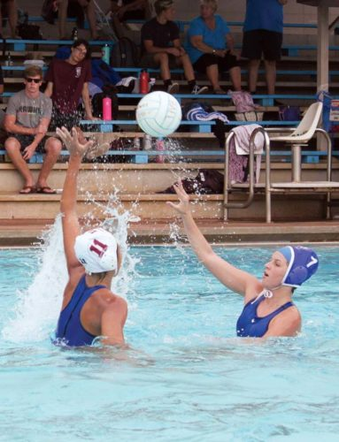 Makena Root of the combined Seabury Hall/Maui High School team passes against Baldwin's Audrey Reiss during the Baldwin Invitational water polo tournament Saturday at Sakamoto Pool in Wailuku. The Bears, who went unbeaten in the two-day tournament, won 13-4 in a match that was called with two minutes remaining due to weather. -- The Maui News / KEHAULANI CERIZO photo