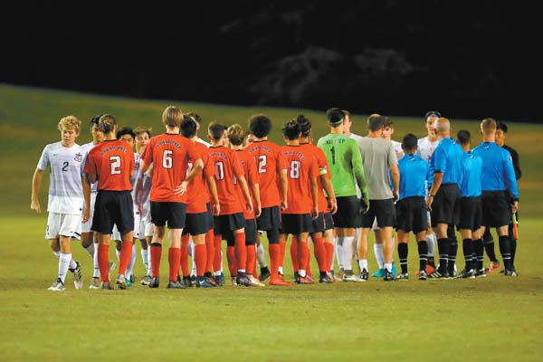 The Baldwin High School and Hawaii Prep boys soccer teams shake hands before the Division I state championship game Saturday at Waipio Peninsula Soccer Stadium on Oahu. The game ended in a 0-0 draw after lightning in the area stopped the match in overtime. ANDREW LEE photos