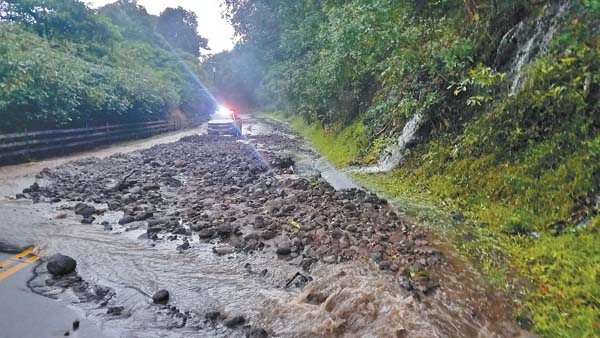 Rocks and debris litter Iao Valley Road after heavy rainfall Sunday afternoon. KAINOA HORCAJO photo