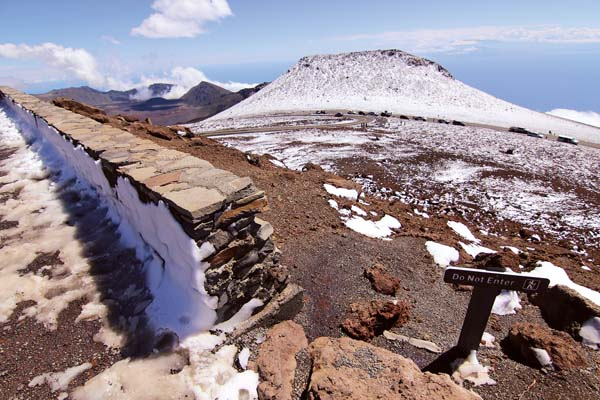 While Haleakala crater remained clear, the summit was coated with snow Monday. Park visitors could also catch a glimpse of snow on Hawaii island in the distance. The Maui News / COLLEEN UECHI photo