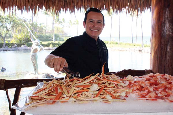 Grand Wailea Executive Sous Chef Jorge Gonzalez serves up crab at the seafood station. GRAND WAILEA and CARLA TRACY photos