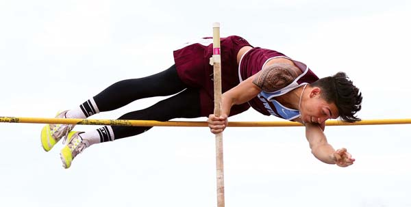 Baldwin High School's Shawn Silva clears 13 feet to win the boys pole vault Friday during the first Maui Interscholastic League meet of the season at Yamamoto Track & Field Facility. -- The Maui News / CHRIS SUGIDONO photo