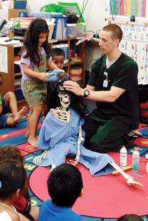 "Troy Osorno was a single parent raising his daughter while attending college to become a radiologist. He now volunteers for Head Start centers to discuss X-rays, MRI and CT scans and ultrasound, while providing various props that children can safely manipulate, including a skeleton he has named ""Skelereena."""