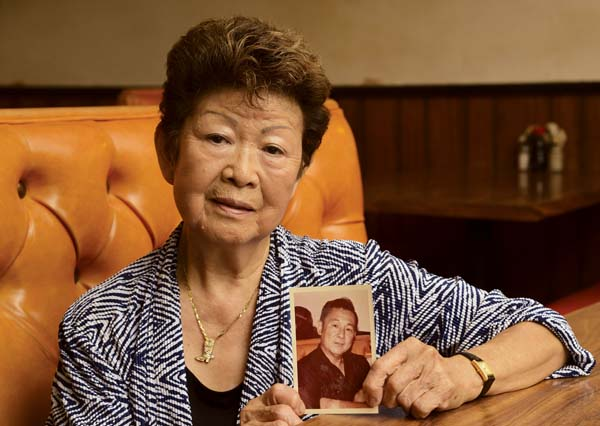 Hifumi Tanaka holds a picture of her late husband, Archie Tanaka, in this 2014 image. Together the couple operated Archie's Restaurant in Wailuku. Their daughter and son-in-law, Margie and Tom Albete, took over the busy eatery around 2007 but last year, after 49 years in business, the mom-and-pop shop closed. -- The Maui News / MATTHEW THAYER photo