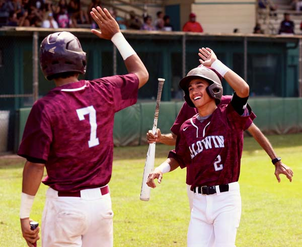 Baldwin High School's Ekolu Cuttie (2) high-fives Jacob Chong after scoring a run in the fourth inning of the Bears' 7-4 win over Saint Louis in a Baldwin Tournament game Saturday at Maehara Stadium. -- The Maui News / CHRIS SUGIDONO photo