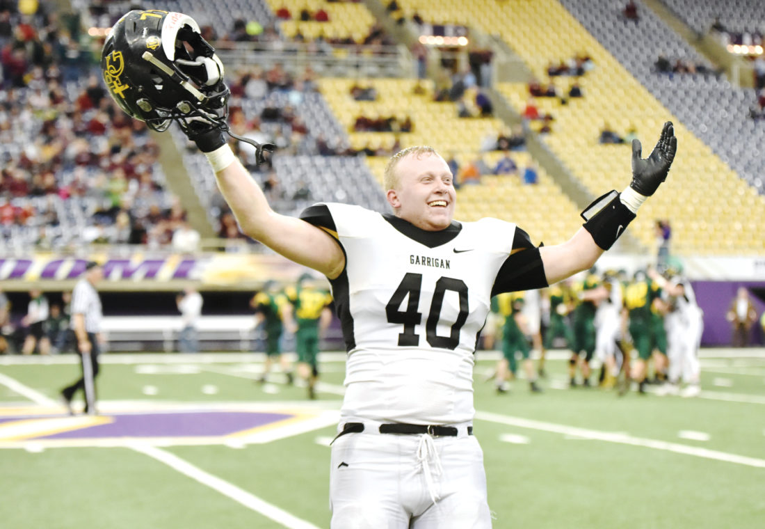 -Messenger photo by Britt Kudla Grant Buscherfeld of Bishop Garrigan reacts to beating St. Alberts 26-20 during class A semifinals on Friday