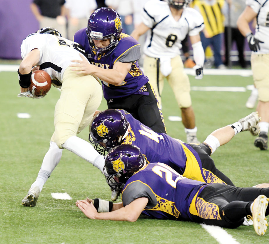 Photo by Troy Banning, for The Messenger  The Webster City defense makes a gang tackle against Glenwood in a Class 3A semifinal at the UNI-Dome in Cedar Falls.