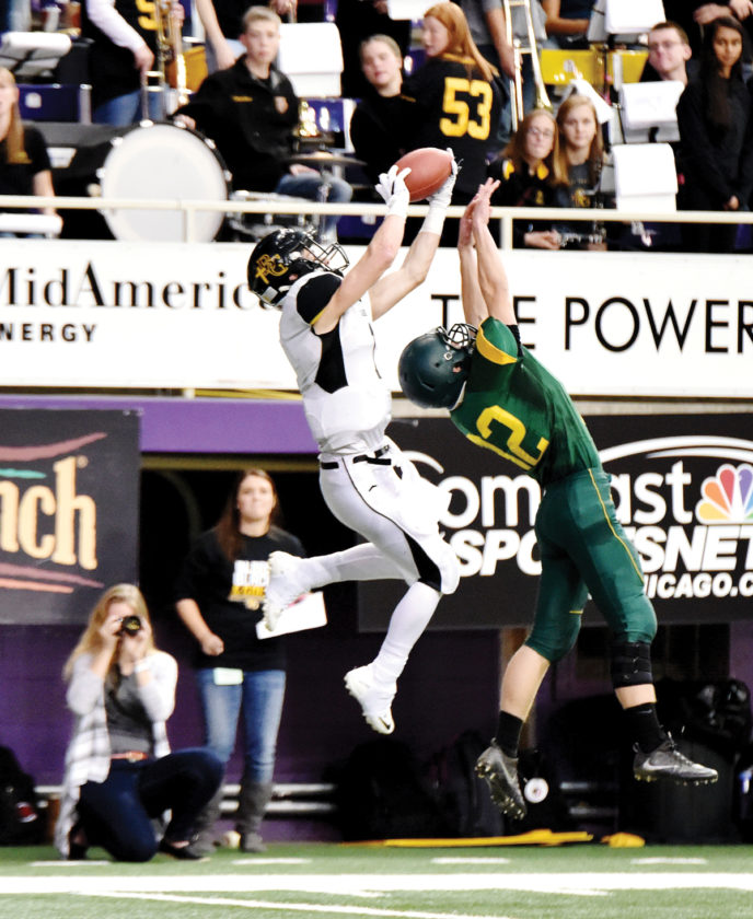 Messenger photo by Britt Kudla Gibson Behr of Bishop Garrigan makes a catch against St. Albert during a Class A semifinal game last Friday inside UNI Dome.