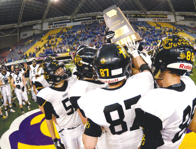 —Messenger photo by Britt Kudla  Bishop Garrigan hoists the Class A runner-up trophy after Thursday's game in Cedar Falls. For more photos, please visit CU.messengernews.net