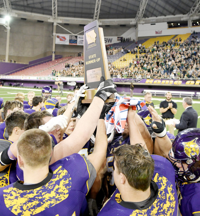 Photo by Troy Banning, for The Messenger  Webster City players hoist the Class 3A state runner-up trophy on Thursday night in Cedar Falls. For more photos, visit CU.freemanjournal.net