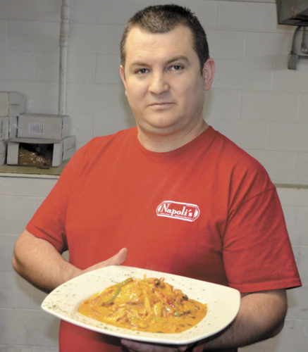 -Messenger photo by Chad Thompson  Tony Avdiu, owner of Napoli's Italian Restaurant, displays a plate of chicken scarparelli, one of the more popular items on the menu at the newly opened restaurant in Fort Dodge.