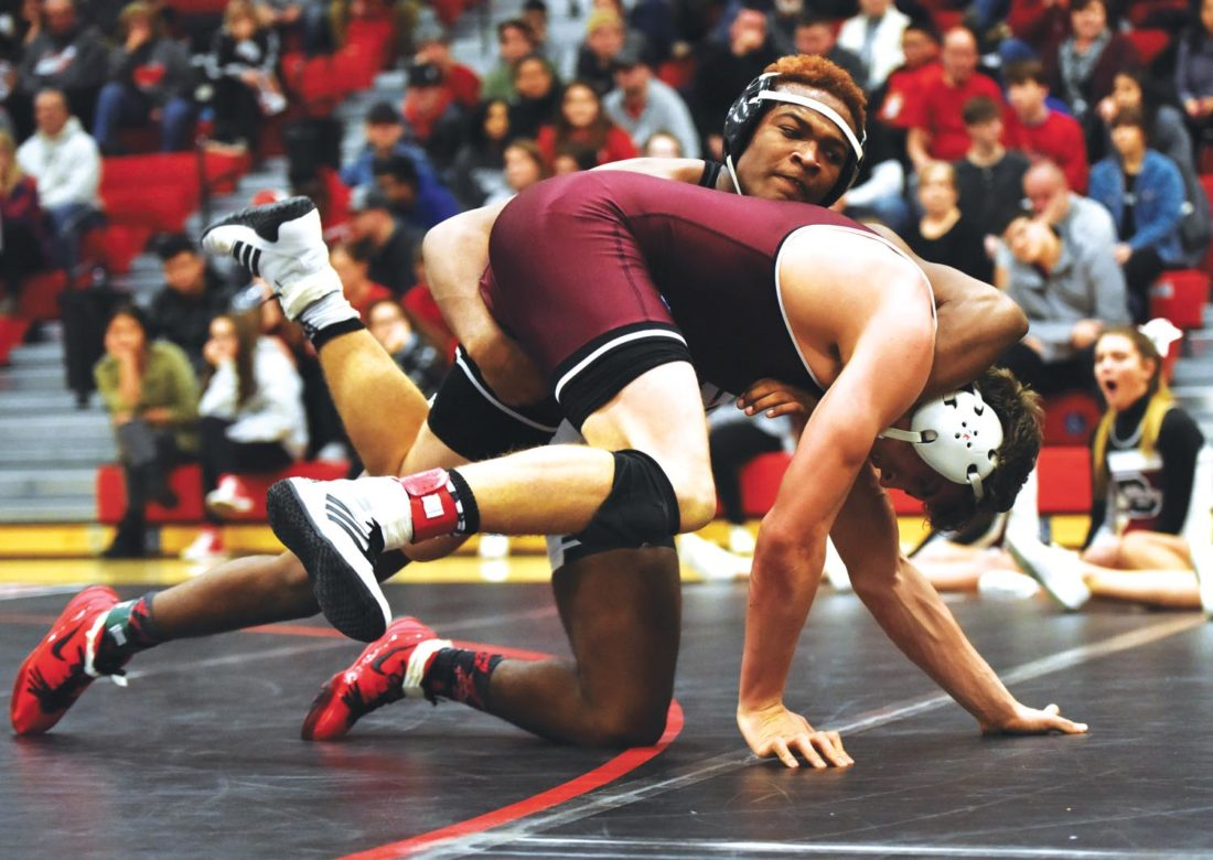 -Messenger photo by Britt Kudla Dorian Franklin of Fort Dodge wrestles against Dowling Catholic's Tanner Deaton on Thursday