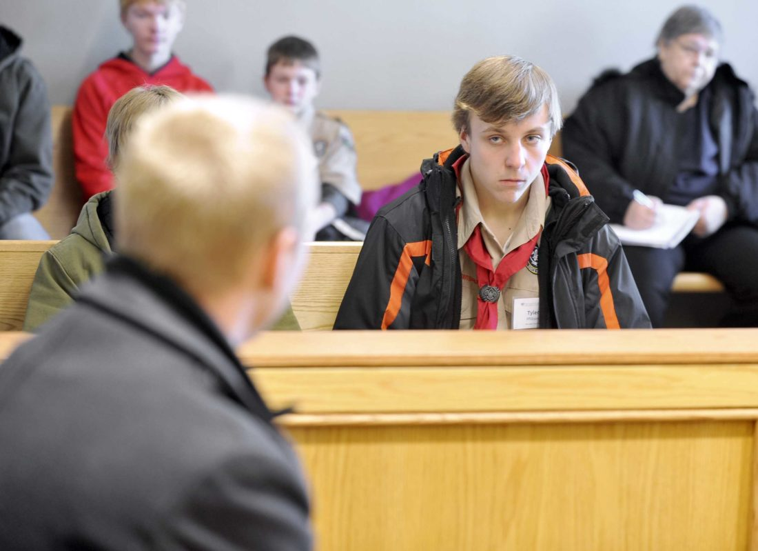 -Messenger photo by Hans Madsen  Boy Scout Tyler Pfilbsen, 14, of Humboldt, a member of Troop 108, listens as Assistant Webster County Attorney Hans Becker talks to a group of Boy Scouts Saturday morning following Magistrate Court in the Webster County Law Enforcement Center. The Scouts were there to learn about how the court system works for their Law Merit Badge as part of a day long Merit Badge College.