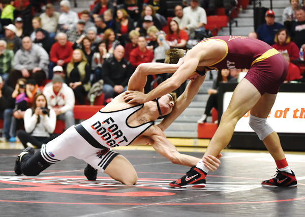 -Messenger photo by Britt Kudla Triston Lara of Fort Dodge wrestles against Ankeny's Hunter Ragan on Thursday