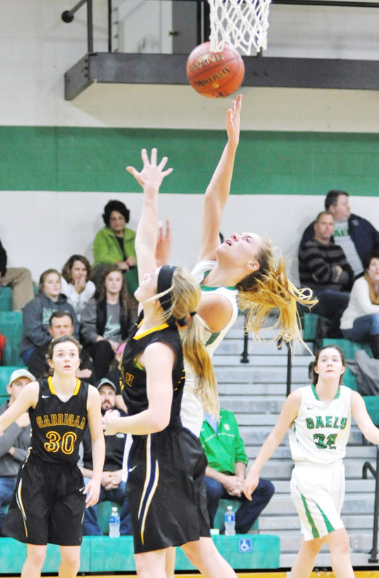 —Messenger file photo  Megan Flattery shoots for St. Edmond earlier this season against Bishop Garrigan in the Gael gym.