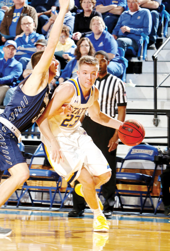 Photo by Dave Eggen/Inertia Sports Media   Reed Tellinghuisen drives to the basket for South Dakota State during a game earlier this year. Tellinghuisen is a graduate of East Sac County.