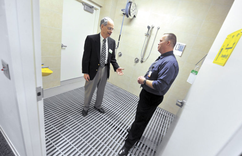 -Messenger photo by Hans Madsen  Dean Barnett, left, gets a look at the decontamination room in the new Trinity Regional Medical Center emergency department with Terry Evans, ambulance supervisor, during an open house Thursday afternoon.