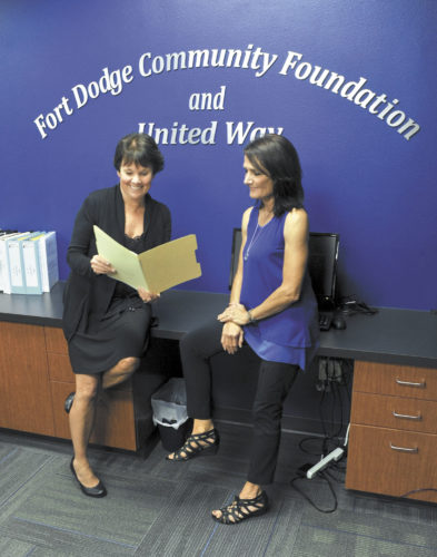 -Messenger photo by Hans Madsen  United Way Program Coordinator Amy Bruno, left, along with Campaign Chair Lisa Wilson, work together on the annual campaign in the offices of the Fort Dodge Community Foundation and United Way.