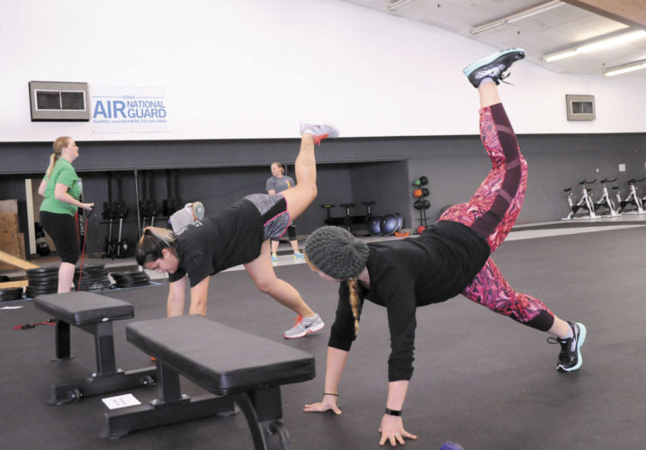 -Messenger photo by Joe Sutter  Instructor Kaila Blomberg, right, instructs Amber Harman in one of the moves in this multi-part workout at the REC Coliseum Tuesday class.