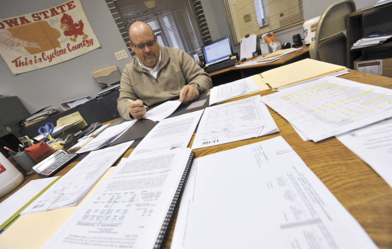 -Messenger photo by Hans Madsen  Lake City Administrator/Clerk Eric Wood works on the new year's budget in his City Hall office.