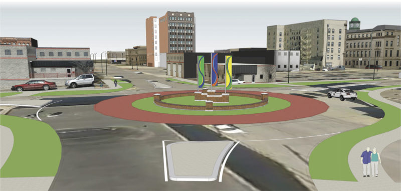 -Submitted graphic  Three metal banners like those shown in this illustration will be placed in the center of the roundabout intersection at First Avenue South and Sixth Street. However, the low brick wall that forms a circle around the base of the banners in the illustration will not be built.