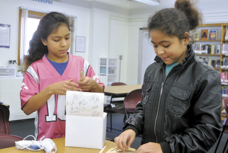 -Messenger photo by Chad Thompson  Twins Shay Camden, left, and Tyhia Camden, both 10, work together in the new makerspace at Robert Blue Middle School recently.