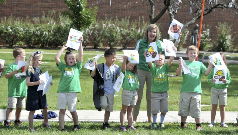 -Messenger photo by Hans Madsen  A group of St. Edmond Elementary School second-graders cheer on the Gaels during the homecoming parade Friday afternoon.