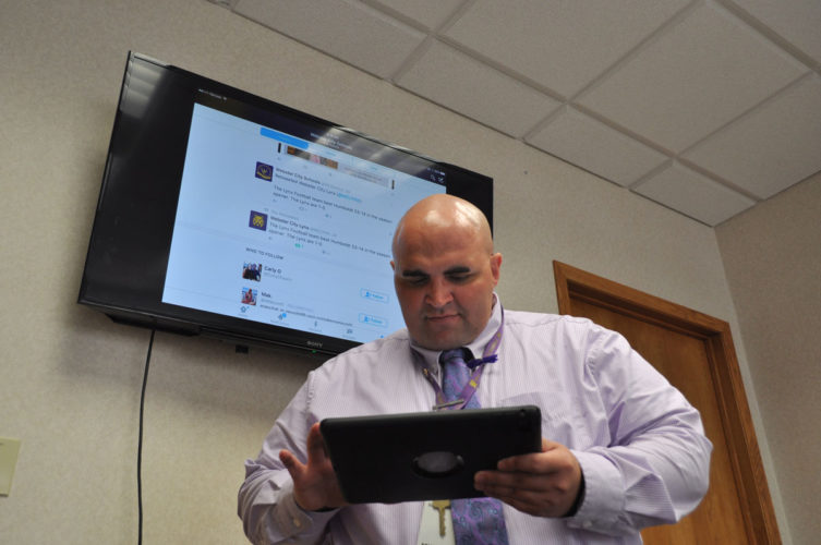 -File photo  Dr. Adam Zellmer posts an item to the Webster City School District's social media page. He said the social media posts reach upwards of 5,000 people — people Zellmer said weren't being reached before.