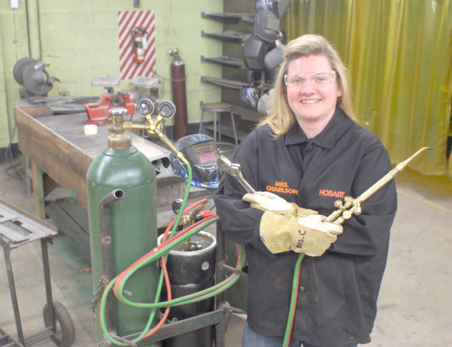 -Messenger photo by Clayton Rye Besides the traditional classroom, ag education includes shop training with an emphasis on safety. Teacher Angie Charlson is at ease in either class setting.