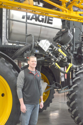 -Photo by Kriss Nelson   Kent Klemme, president of Hagie Manufacturing, poses beside a sprayer in Hagie's manufacturing plant in Clarion.