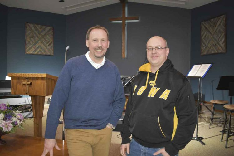 -Messenger photo by Chad Thompson Scott Hatton, senior pastor, left, and Gabe Casciato, pastor for family life, pose together inside the sanctuary at CrossWay Church in Fort Dodge recently.
