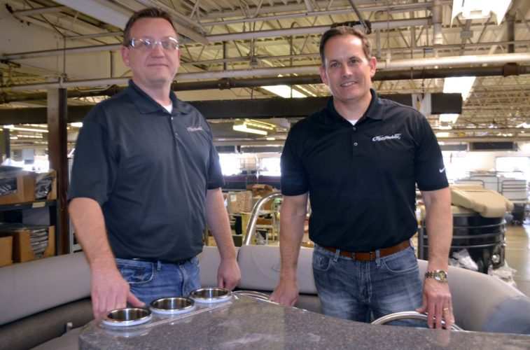 -Messenger photo by Chad Thompson  Tom Christy, vice president of Misty Harbor, left, and John Jergens, president, stand inside one of their luxury pontoons at Misty Harbor in Fort Dodge, recently.