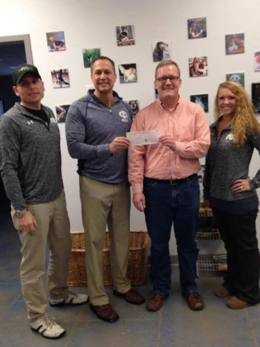During the month of December, The Rec ran a promotion where the first month's payment on all new memberships were donated to Almost Home. The Rec was able to donate a check of almost $1,600 and also donated containers of kitty litter from the members of The Rec to help out. Pictured from left are Matt Hanson, Dave Pearson, Chad Hammer and Kaila Blomberg.