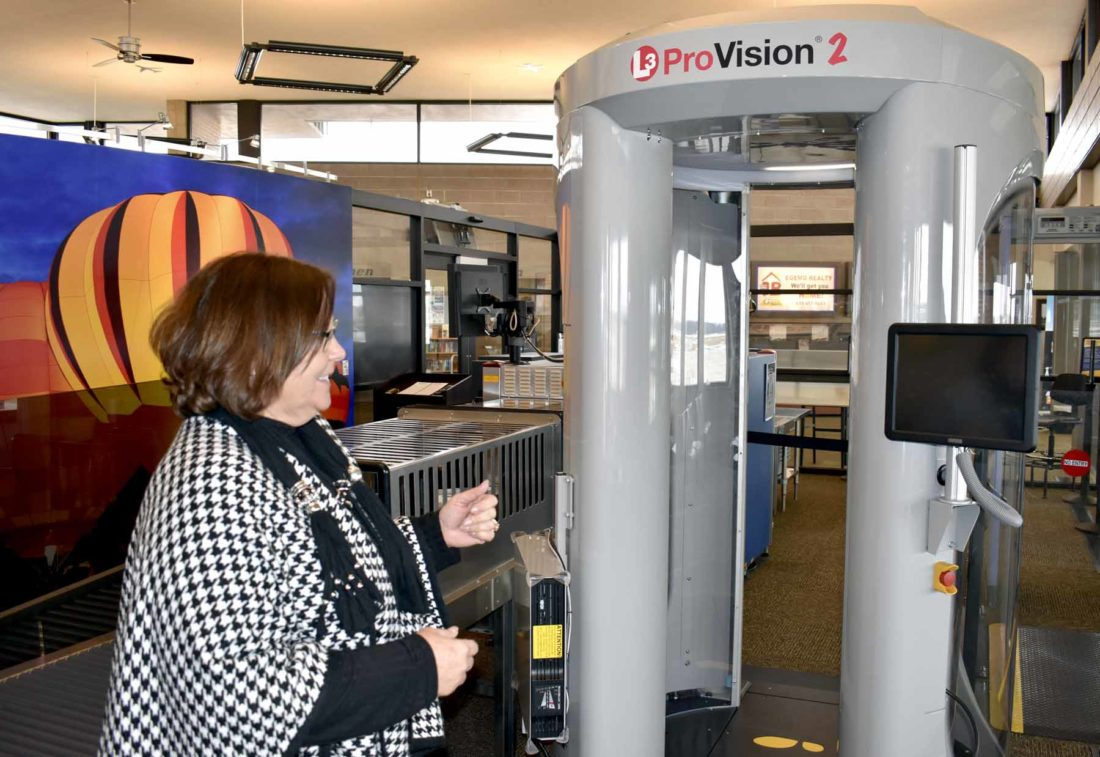 -Messenger photo by Chad Thompson  Rhonda Chambers, director of aviation, shows off the latest checkpoint screening technology at the Fort Dodge Regional Airport, recently.