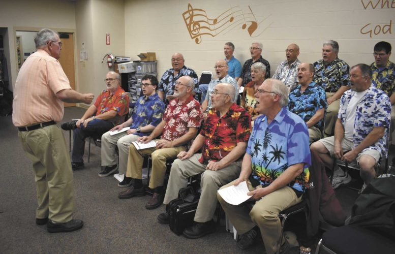 -Messenger photos by Chad Thompson Clair Nerem leads the Harmony Brigade during a rehearsal at First Presbyterian Church recently. Nerem is the 11th director in 70 years for the Fort Dodge Harmony Brigade.