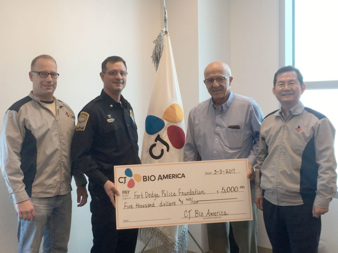CJ Bio America recently donated $5,000 to the Fort Dodge Police Foundation. Pictured from left are Senior Operations Manager Luke Palmer, Fort Dodge Assistant Police Chief Roger Porter, President/CEO JT Nam and Fort Dodge Police Chief Kevin Doty.
