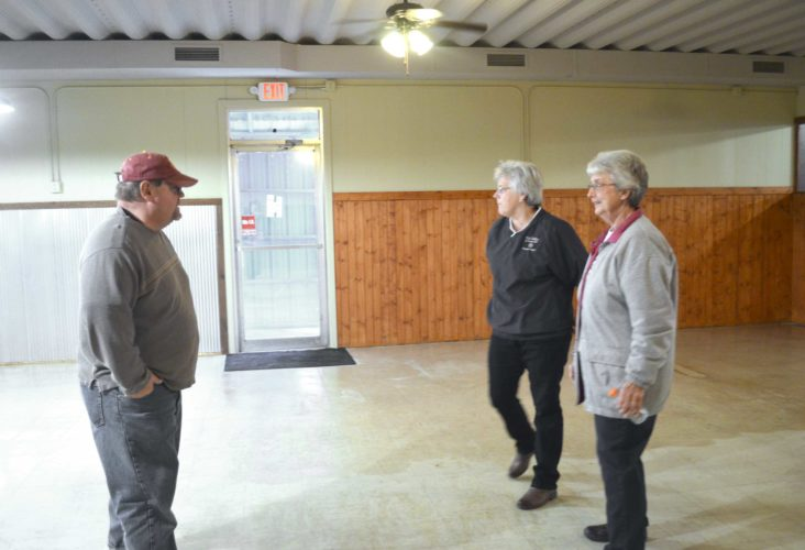 -Messenger photo by Kriss Nelson  Doug Johnson, president of the Farnhamville Betterment Inc., visits with Juanita Borland and Emily Bendickson about all of the work that has been done to the building which was formerly Tony's Steakhouse. The group has renovated the building and are on the search for a tenant to lease it in hopes of opening up a new restaurant and bar in the small Calhoun County town.