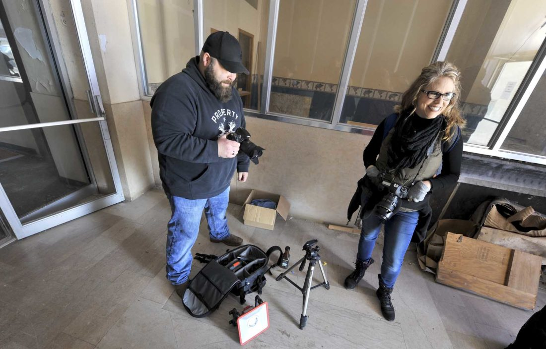 -Messenger photo by Hans Madsen  Photographers Jason Liska, at left, and Sheila Hansen, both of Fort Dodge, ready their gear for a Fort Dodge Area Camera Club photo safari in the Warden Plaza Saturday afternoon. A series of late week and weekend photo safari were the last opportunity for the group to explore the old building before some of the preliminary work gets under way.