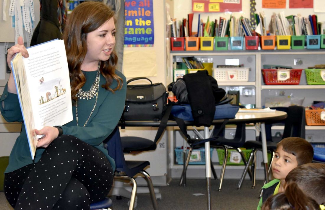 -Messenger photo by Chad Thompson  Jenn Becker, a first grade teacher at Butler Elementary School, reads to her students at the school recently.