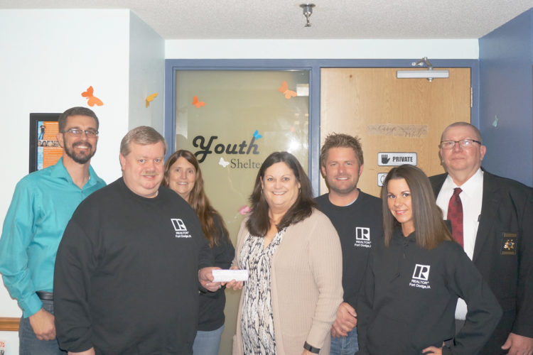 The Fort Dodge Board of Realtors MLS presented Youth Shelter Care with a $500 donation. Pictured from left are YSC board member Troy Anderson, Realtor Gery Cook, Realtor Jessica Sanders, YSC Executive Director Pat Cirks, Realtor Kyle Olson, Realtor Tami Anderson, Webster County Sheriff Jim Stubbs.