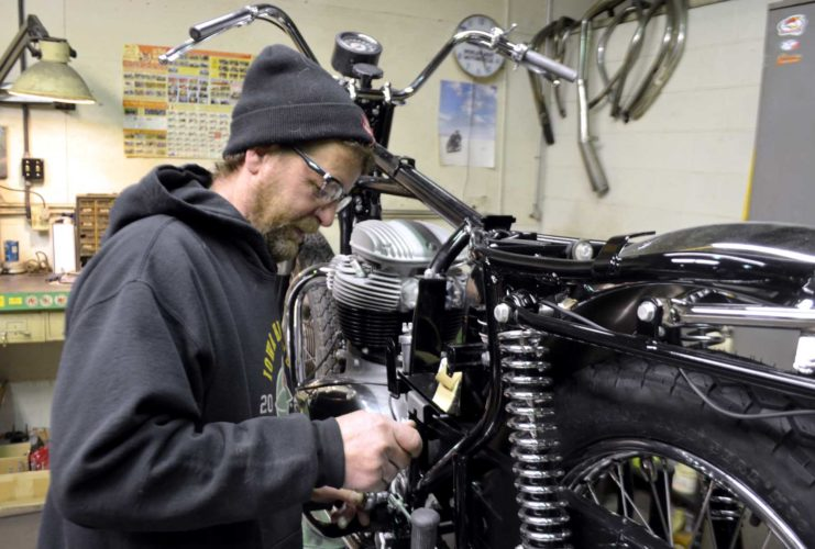 -Messenger photo by Joe Sutter  Don Nevins works on a 1969 BSA at Cycle Service. Nevins specializes in restoring classic British motorcycles like this one, for customers from all over the country.